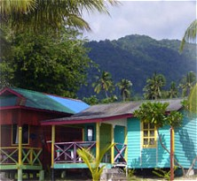 Basic but comfy wooden chalets are located right on a stretch of bounty beach